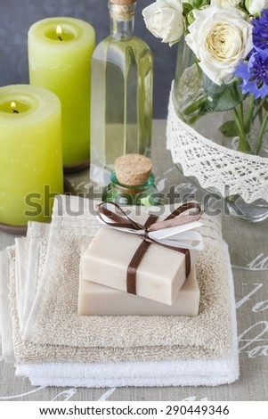 Bars of handmade soap, essential oil and scented candles - stock photo