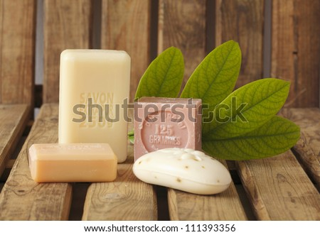 Bars of handmade soaps with leaf - stock photo