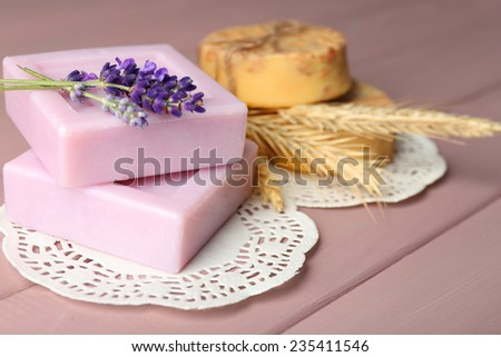 Bars of natural soap on wooden background