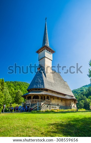 BARSANA MONASTERY - AUGUST 9. Unidentified tourists visiting Barsana monastery on August 9, 2015. Maramures area, Romania - stock photo