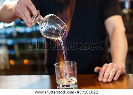 bartender burning Sambuca at the bar