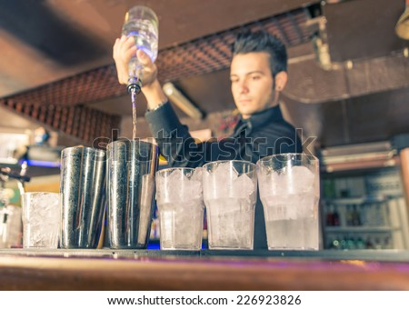 bartender in action. american freestyle pouring - stock photo