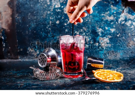 bartender mixing alcoholic cocktail at bar or pub. drinks and refreshments at restaurant - stock photo