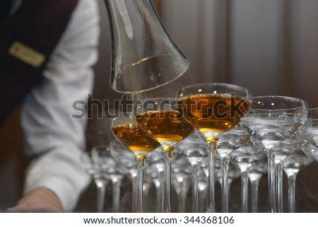 bartender pours a cocktail at the bar glasses - stock photo