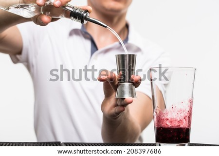 bartender preparing coctail with bar equipment, studio shoot