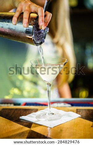 Bartender preparing Limoncello martini coctail. - stock photo