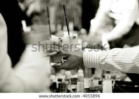 bartender serves drinks, motion blurred - stock photo