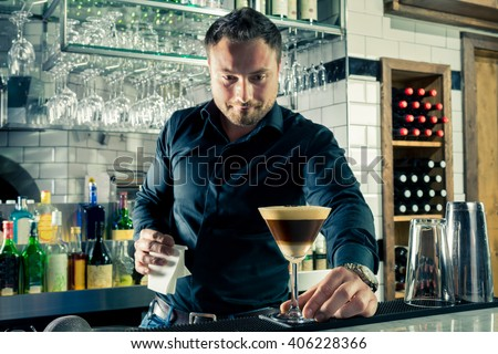 Bartender serving espresso martini layered cocktail coffee vodka bar shaker - stock photo
