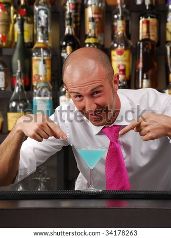Bartender working. Barkeeping pointing a cocktail. Bantender and cocktail - stock photo