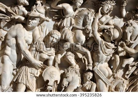 Bas-relief and sculpture of ancient Roman warriors - stock photo