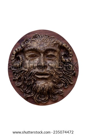 Bas-relief Faunus  of the Greek deity made on wood isolated on white background - stock photo