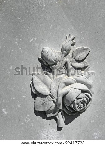 Bas-relief floral theme on nineteenth century gravestone - stock photo