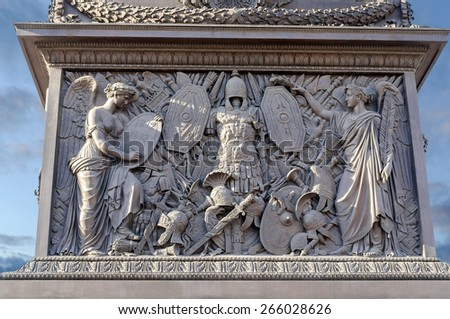 "Bas-relief on the pedestal of the Alexander Column in Saint-Petersburg with figure of Victory, holding up in the history books memorable dates: ""1812 1813 1814"". - stock photo"