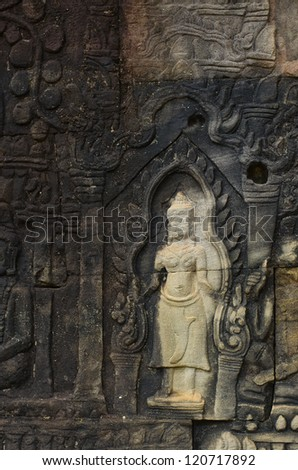 Bas relief wall art at Angkor Thom Bayon temple in Cambodia depicting a heavenly being called & Bas Relief Wall Art Angkor Thom Stock Photo (100% Legal Protection ...