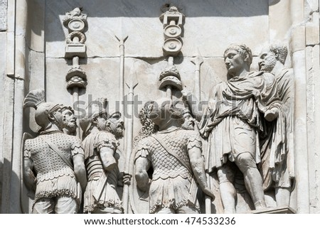 Bas-relief with the image of the emperor who makes speech to the army. Fragment of an arch of Constantine. Rome. Italy.