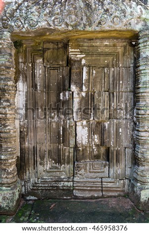 bas-reliefs of devatas and blind door in the archaeological pre rup place in siam reap, cambodia