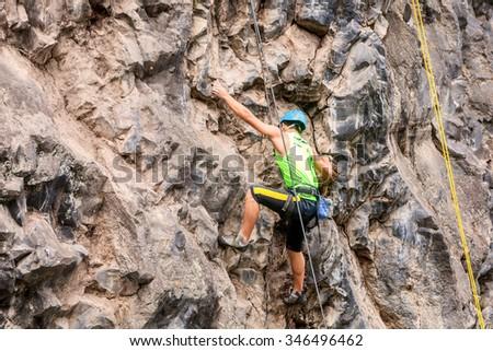 Basalt Challenge Of Tungurahua, Man Climbing Vertical Rock Wall  - stock photo