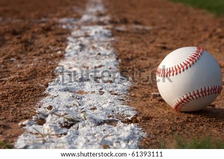 Baseball along the baseline - stock photo