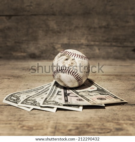 baseball and dollars, concept sport betting and finances - stock photo