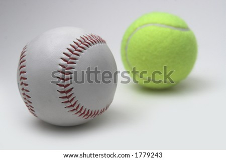 baseball and tennis ball isolated on grey background
