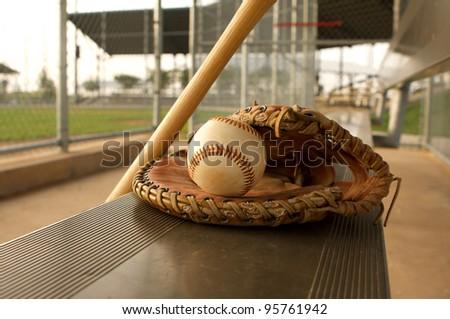 Baseball & Baseball Glove on the Bench - stock photo