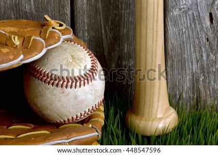 Baseball ,bat and ball on green grass. - stock photo