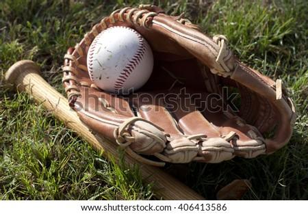 baseball bat, ball and glove on grass - stock photo