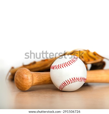Baseball bat with ball and baseball glove on wood background - stock photo