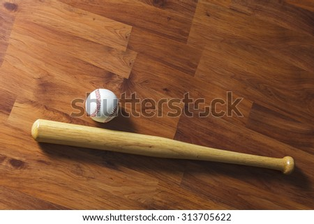 Baseball bat with ball on wood background - stock photo