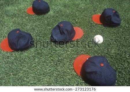 Baseball caps and ball on field, Candlestick Park, San Francisco, CA - stock photo