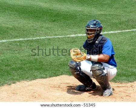 baseball catcher in gear - stock photo