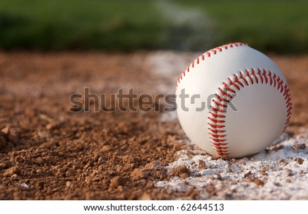 Baseball close up on the chalk line with room for copy