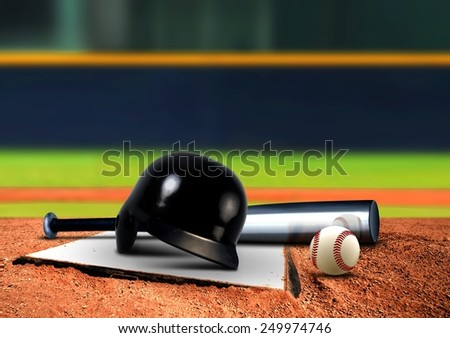 Baseball equipment on base - stock photo