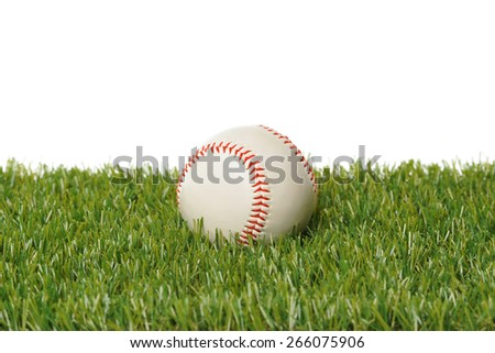 Baseball in grass with white background