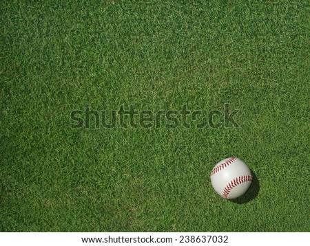 Baseball on green sports turf grass.                                - stock photo