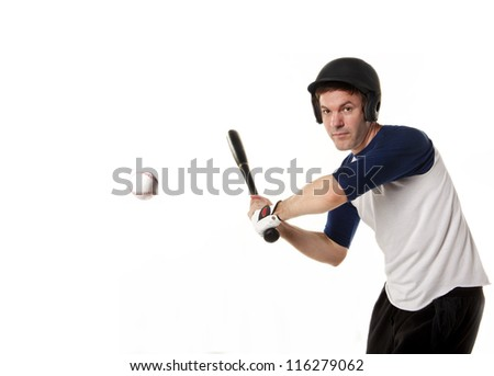Baseball or softball player at bat hitting a ball and isolated on white. - stock photo
