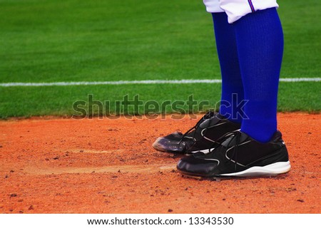 Baseball pitcher, standing on the mound