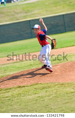 Baseball pitcher throwing the ball.