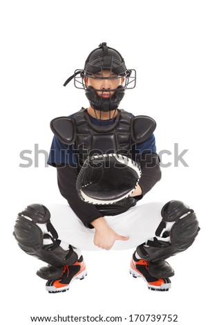 baseball player , catcher showing direction secret  signal - stock photo