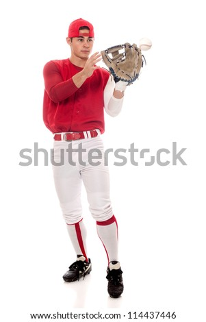 Baseball player fielding. Studio shot over white.