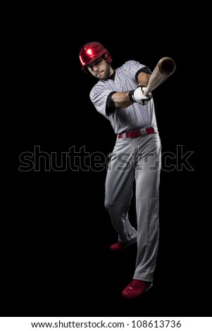 Baseball Player on a black backgrond. - stock photo