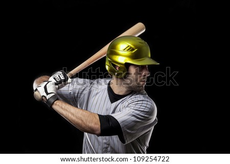Baseball Player on a yellow uniform.