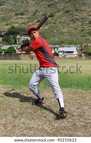 Baseball player ready to swing the bat - stock photo