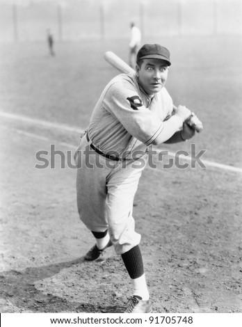 Baseball player swinging the bat - stock photo