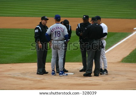 Baseball Teams Rangers vs Yankees and Umpires. - stock photo