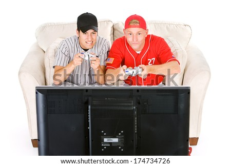 Baseball: Two Friends Play Sports Videogames - stock photo