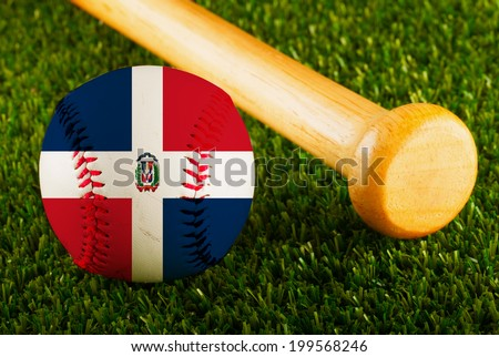 Baseball with Dominican Republic flag and bat over a background of green grass - stock photo
