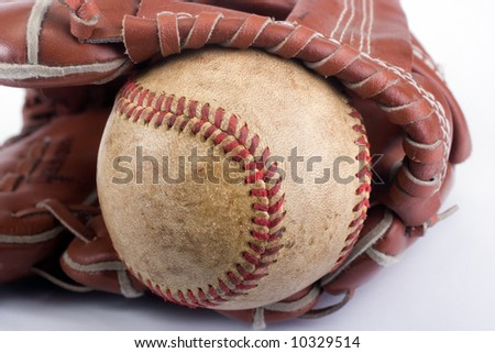 baseball with red stitching and outfielders glove (mitt), sports