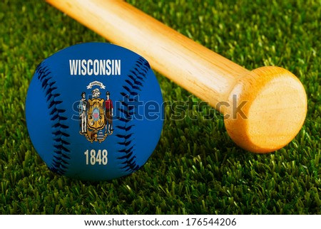 Baseball with Wisconsin flag and bat over a background of green grass - stock photo