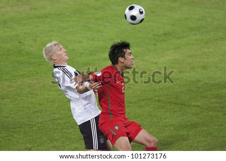 BASEL, SWITZERLAND - JUNE 19:  Bastian Schweinsteiger of Germany (l) battles Portugal's Deco (r) during a UEFA Euro 2008 match June 19, 2008 in Basel, Switzerland. Editorial use only. - stock photo